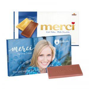 100 g Tafelschokolade merci Edel-Rahm mit Werbebanderole und Werbedruck