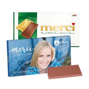 100 g Tafelschokolade merci Mandel-Milch-Nuss mit Werbebanderole und Werbedruck