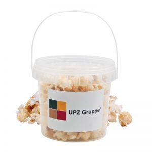 30 g süßes Popcorn im transparenten Eimer mit Werbe-Etikett